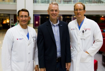 Rep. Steve Russell with STS members Jess L. Thompson III, MD (left) and Harold M. Burkhart, MD (right) at the Children's Hospital of Oklahoma.